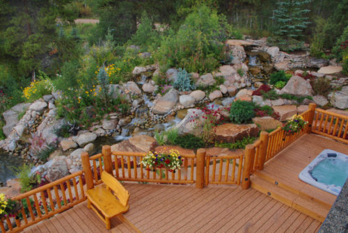A rustic, log fence surrounds the deck and waterfalls and provide perfect overlooks to the streams and falls